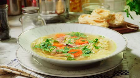 Serving the chicken noodle soup Stok Video