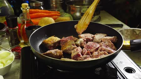 Preparing Irish stew: beef, potatoes, carrots and herbs. Traditional St. Patricks day dish