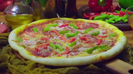Delicious pizza with bacon, pepperoni and bell pepper. Italian cuisine Стоковые видеозаписи