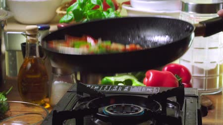 omeleta : Frying vegetables for preparing frittata. Italian cuisine