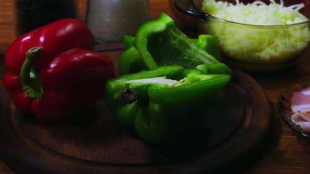 Ingredients for preparing pizza with bacon, pepperoni and bell pepper Стоковые видеозаписи
