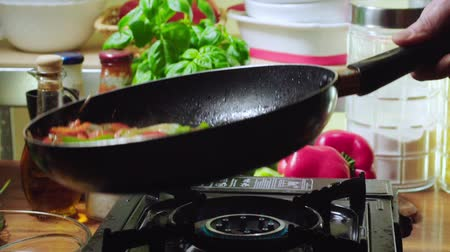 omlet : Frying vegetables for preparing frittata. Italian cuisine