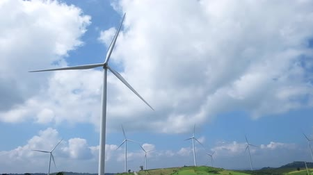 producing energy : wind turbine with blue sky background, wind energy.