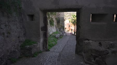roman : Walking through the gates of the citadel at Lipari town, Italy Stok Video