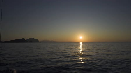 Сицилия : Sunset over the water in the Mediterranean Sea near Sicily, Italy Стоковые видеозаписи
