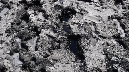 quebradiço : Traces of human feet in the salt lake of mud. The surface of the salt lake. Stock Footage
