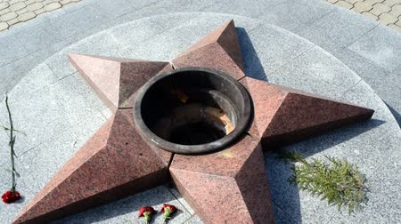 five stars : Burning of eternal fire. Five-pointed star made of granite memorial to the memory of killed soldiers.