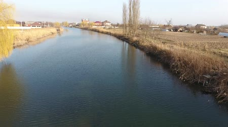 kuban : River eric current in the village in the spring. Shallow river, slowly flowing in the village