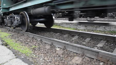 camionagem : Movement of a freight train. Tanks on rails. Wheels of the train.