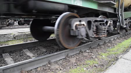 sleepers : Movement of a freight train. Tanks on rails. Wheels of the train.