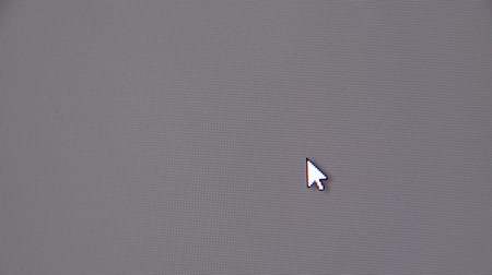 kursor : Moving the mouse cursor over the gray screen of the monitor. Wideo