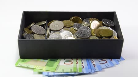 Coins are thrown in a box. Piggy bank of Russian money. Russian rubles Стоковые видеозаписи