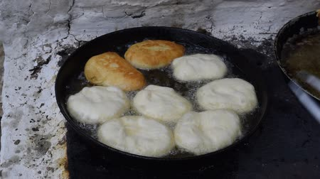 Fry the patties in oil in a frying pan on the stove. Traditions of cooking pies. Appetizing toasted pies.