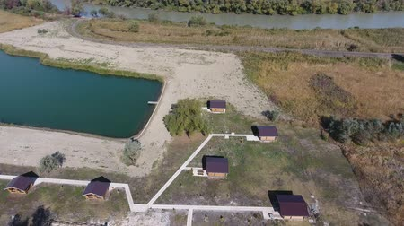 Top view of the recreation center by the river, near the sea. Hunting recreation center. tourist lodges for hunters. Lake for fishermen.