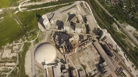 desolado : Verkhnebakansky cement plant, top view. Factory for the production and preparation of building cement. Cement industry. Stock Footage