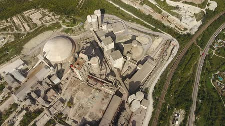 Verkhnebakansky cement plant, top view. Factory for the production and preparation of building cement. Cement industry. Stock Footage