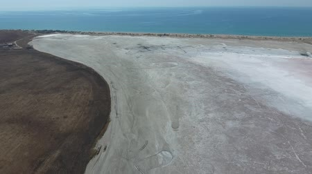 benzer : Saline Salt Lake in the Azov Sea coast. Former estuary. View from above. Dry lake. View of the salt lake with a birds eye view. Stok Video