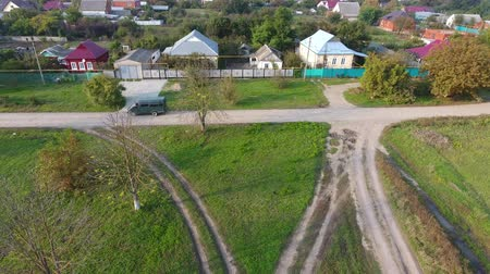 kuban : Landing drone on a dirt road. Top view of the village. One can see the roofs of the houses and gardens. Road and water in the village. Village birds-eye view.