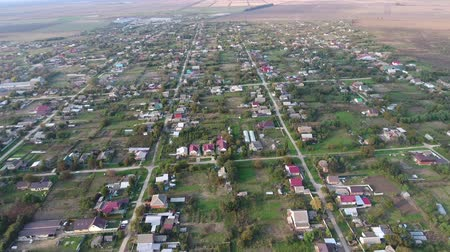 kuban : Top view of the village. One can see the roofs of the houses and gardens. Road and water in the village. Village birds-eye view.