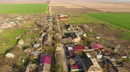 резидент : Top view of the village. One can see the roofs of the houses and gardens. Road the village. Village birds-eye view.