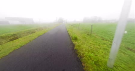 ciclismo : timelapse from a point of view on a bicycler in the fog at nighttime Stock Footage