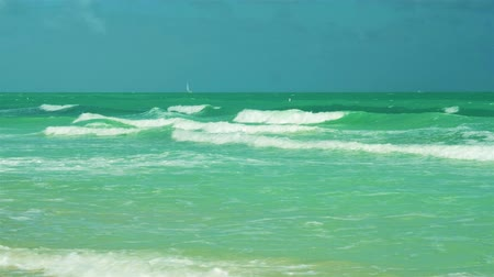 Super high definition video of waves coming ashore on a windy day in popular Miami Beach.