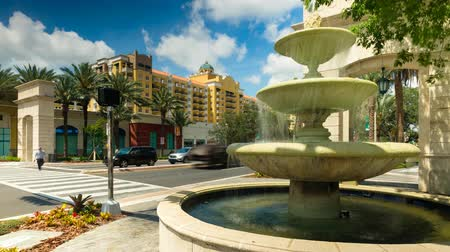 Coral Gables, Florida USA - May 9, 2018: Cityscape time lapse video of the popular Miracle Mile in the historic downtown district of this Mediterranean style community in Miami.