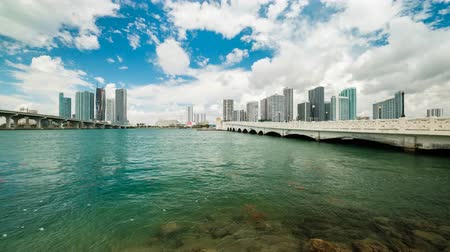 Time lapse video of the downtown Miami skyline viewed from Biscayne Bay along the Venetian Causeway. Stock mozgókép