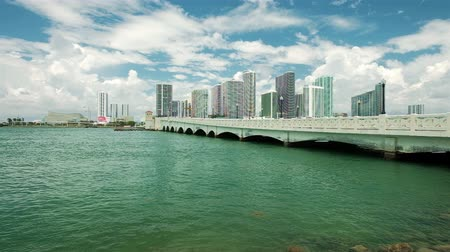 Slow motion video of the downtown Miami skyline viewed from Biscayne Bay along the Venetian Causeway. Stock mozgókép