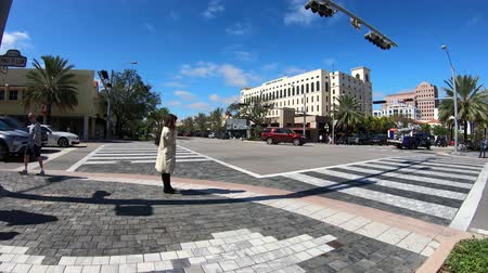Coral Gables, Florida USA - January 28, 2019: Motion time lapse video of the popular Miracle Mile in the historic downtown district of this Mediterranean style community. Stock mozgókép