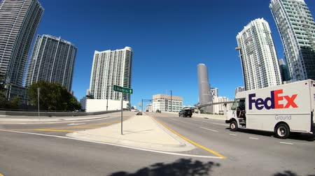 Miami, Florida USA - January 29, 2019: Super high definition motion time lapse video of the popular Brickell district with cars and pedestrians passing by. Stock mozgókép