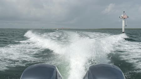 High definition slow motion video of the rear view of a outboard motor boat cruising along Biscayne Bay in Miami.
