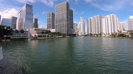 набережная : Miami, Florida USA - February 15, 2019: Motion time lapse video of the Brickell downtown district along Biscayne Bay with modern skyscrapers.