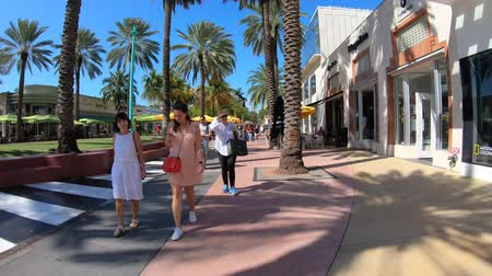 Miami Beach, Florida USA - February 19, 2019: Hyperlapse video walking along the popular outdoor Lincoln Road Mall with retail stores and restaurants.