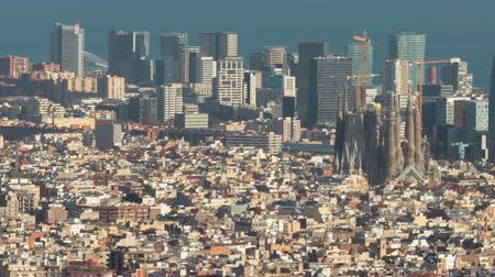architecture and urbanism : Barcelona downtown top view.Hyper Lapse. The Big city with the Holy Family, the technological district 22 @ and the sea of ??background, and with the movement of shadows in buildings. Smooth camera movement: Panning Right. Stock Footage