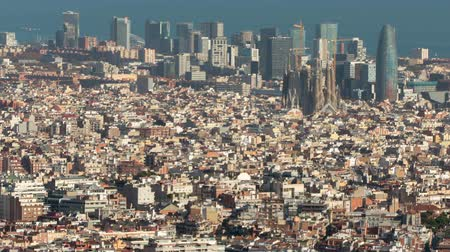 architecture and urbanism : Barcelona downtown top view.Time Lapse. The Big city with the Holy Family, the technological district 22 @ and the sea of ??background, and with the movement of shadows in buildings. Stock Footage