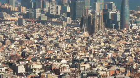 architecture and urbanism : Barcelona downtown top view.Hyper Lapse. The Big city with the Holy Family, the technological district 22 @ and the sea of ??background, and with the movement of shadows in buildings. Smooth camera movement: tilt up.