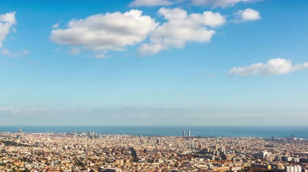 architecture and urbanism : Panoramic view of Barcelona at sunny day.Hyper Lapse The great city with the sea of ??background and the clouds motion.Smooth camera movement: Panning Righ.Time Lapse