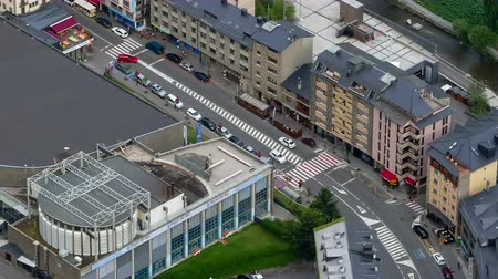 architecture and urbanism : Andorra from above. Aerial view of Canillo town with traffic and people in motion.Five seconds of fixed plane + nine seconds of smooth camera movement: Panning Right.Time Lapse