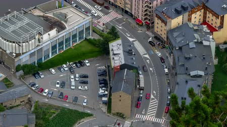 architecture and urbanism : Andorra from above. Aerial view of Canillo town with traffic and people in motion.Four seconds of fixed plane + ten seconds of smooth camera movement: Zoom out .Time Lapse
