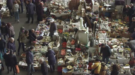 jumble : Els Encants flea market in Barcelona. Jumble sale to hunt for vintage and secondhand treasures, recommended tourist visit. Smooth camera movement: tilt up.