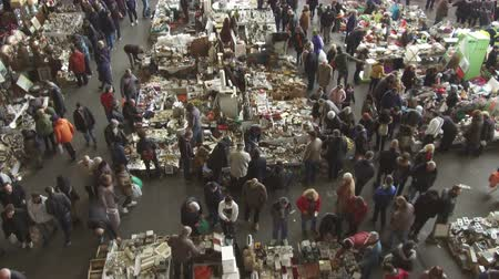 jumble : Els Encants flea market in Barcelona. Jumble sale to hunt for vintage and secondhand treasures, recommended tourist visit. Smooth camera movement: tilt down. Stock Footage