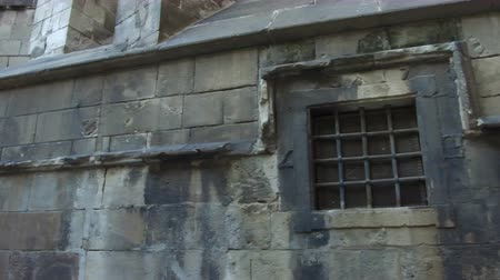 grating : Ancient Barcelona, ??Gothic Quarter. Detail wall with medieval windows with grilles.Smooth camera movement: Tracking Shot left.