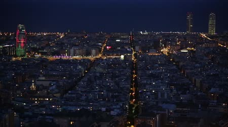 architecture and urbanism : Wide view of Barcelona at dusk, with the Agbar Tower animated lighting and traffic movement. Time Lapse