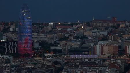 architecture and urbanism : Night view of the Agbar tower in Barcelona with moving city traffic.Time Lapse Stock Footage