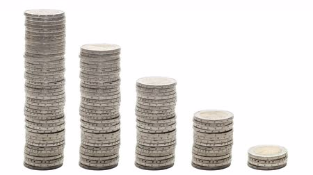 mean : Five stacks of coins decreasing - Stop Motion. Concept of poverty, ruin, failure.