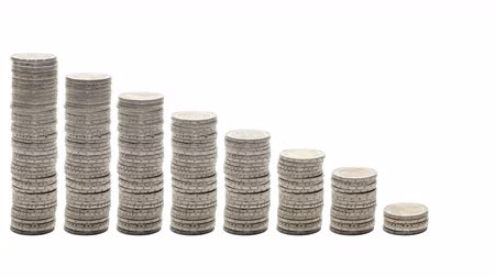mean : Nine stacks of coins decreasing - Stop Motion. Concept of poverty, ruin, failure.