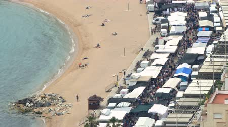 jumble : Aerial view of BLANES, beach and street market. Village of the province of Girona (Catalonia), a weekly street market day in springtime with movement of people.