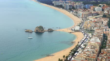 jumble : Aerial view of BLANES, beaches, seafront, and town. Village of the province of Girona (Catalonia), wide panoramic with movement of people and traffic.