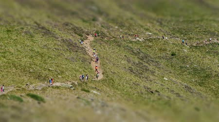 tilt shift : Mountain road with many hikers. Seen from a distance and with a perspective that looks like human ants of fast movement, in ORDINO ARCALIS - ANDORRA.Tilt-shift effect.Time Lapse. Stock Footage